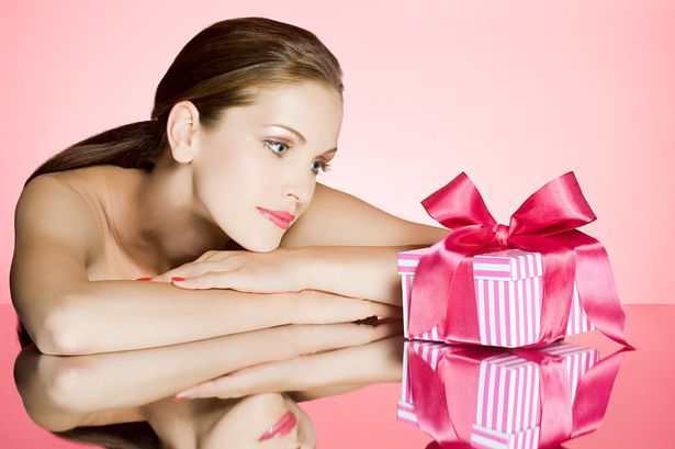 Young-woman-looking-at-gift